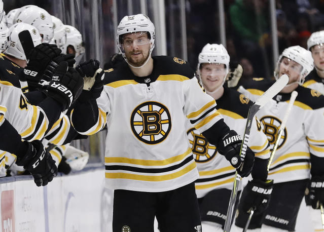Boston Bruins center Sean Kuraly celebrates with teammates after scoring a goal during the second period of an NHL hockey game against the New York Islanders Tuesday, March 19, 2019, in Uniondale, N.Y. (AP Photo/Frank Franklin II)