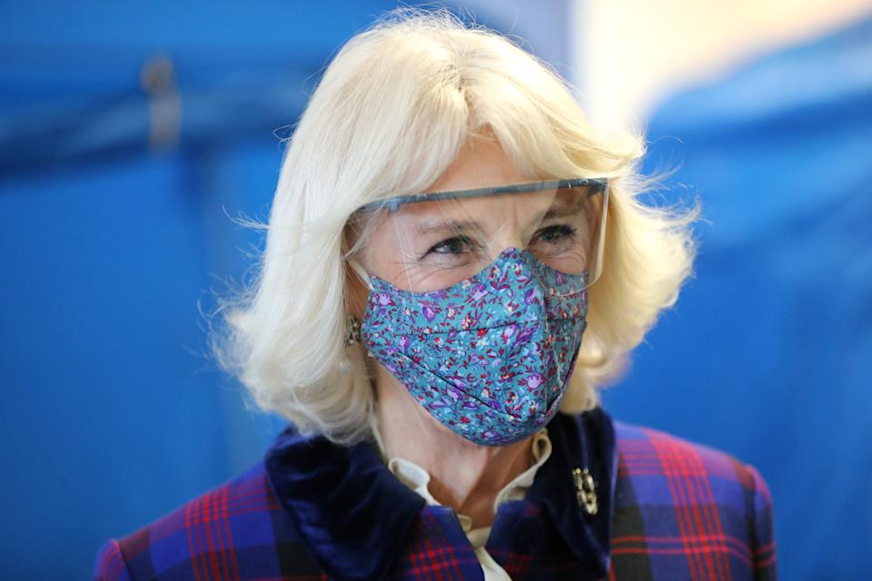 GLOUCESTER, ENGLAND - DECEMBER 17: Camilla, Duchess of Cornwall wears a face-mask and protective glasses during a visit to Gloucestershire Vaccination Centre at Gloucestershire Royal Hospital on December 17, 2020 in Gloucester, England. Gloucestershire Hospitals NHS Foundation Trust is one of the largest non-specialist Trust's in England, The Trust is the designated Management and Coordination Centre for the roll out of the COVID-19 Vaccination Programme for Gloucestershire. Their Royal Highnesses The Prince of Wales and The Duchess of Cornwall previously visited Gloucestershire Royal Hospital in June of this year, the first engagement outside of a Royal residence by any Member of the Royal Family following the first national lockdown. (Photo by Chris Jackson/Getty Images)