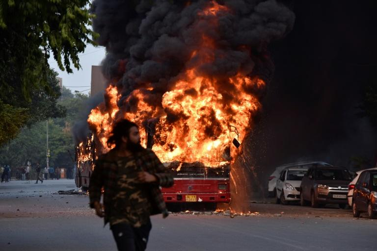 Critics believe the law is part of leader Narendra Modi's Hindu nationalist agenda to marginalise India's 200 million Muslims -- protesters torched vehicles in New Delhi