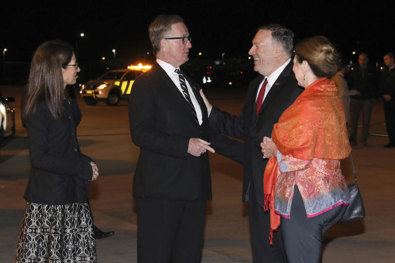 U.S. Secretary of State Mike Pompeo, second from right, and his wife Susan, right, are greeted by U.S. Ambassador to Australia Arthur Culvahouse and U.S. Consul General Sharon Hudson-Dean as they arrive aboard his plane in Sydney Saturday, Aug. 3, 2019. (Jonathan Ernst/Pool Photo via AP)