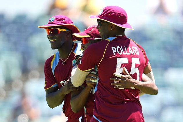 PERTH, AUSTRALIA - FEBRUARY 03: Darren Sammy and Kieron Pollard of the West Indies congratulate Darren Bravo after catching Aaron Finch of Australia during game two of the Commonwealth Bank One Day International Series between Australia and the West Indies at WACA on February 3, 2013 in Perth, Australia.  (Photo by Paul Kane/Getty Images)