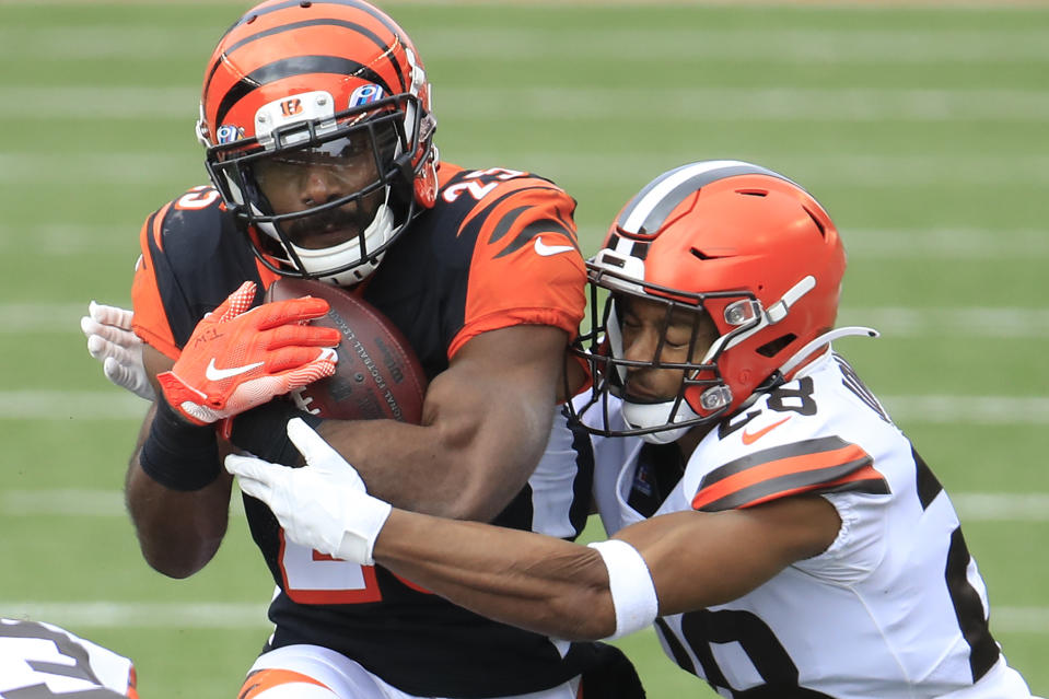 CINCINNATI, OHIO - OCTOBER 25:  Giovani Bernard #25 of the Cincinnati Bengals is wrapped up by Kevin Johnson #28 of the Cleveland Browns during the first half at Paul Brown Stadium on October 25, 2020 in Cincinnati, Ohio. (Photo by Andy Lyons/Getty Images)