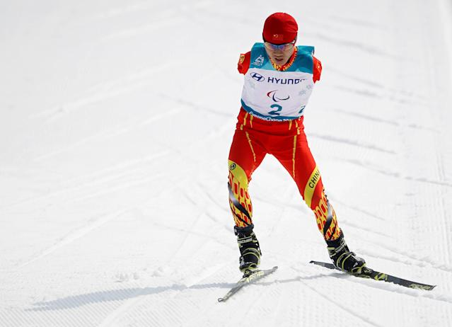 Cross-Country Skiing - Pyeongchang 2018 Winter Paralympics - Men's 20km Free - Standing - Alpensia Biathlon Centre - Pyeongchang, South Korea - March 12, 2018 - Wang Chenyang of China competes. REUTERS/Carl Recine