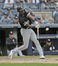 Chicago White Sox's Tim Anderson hist a grand slam during the fourth inning of a baseball game against the New York Yankees at Yankee Stadium, Sunday, April 14, 2019, in New York. (AP Photo/Seth Wenig)