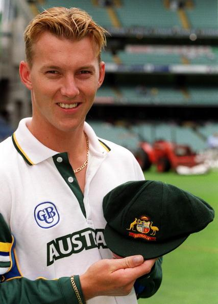 26 Dec 1999:  Test debutant Brett Lee of Australia is presented with his baggy green cap before the Boxing Day Cricket Test match between Australia and India at the Melbourne Cricket Ground, Melbourne, Australia. Bad light stopped play with Australia on 3 for 138. (Photo by Hamish Blair/Getty Images)
