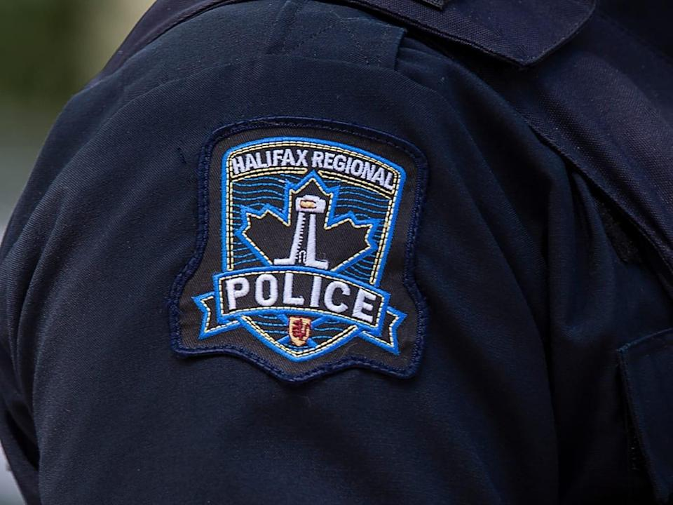 A Halifax Regional Police emblem is seen on a police officer in Halifax on July 2, 2020.  (Andrew Vaughan/The Canadian Press - image credit)