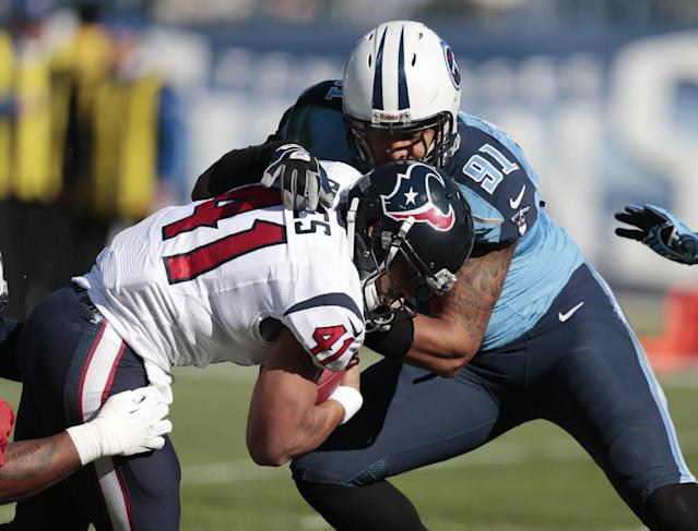 Houston Texans running back Jonathan Grimes (41) gets past Tennessee Titans defensive end Derrick Morgan (91) as Grimes scores a touchdown on a 3-yard run in the first quarter of an NFL football game Sunday, Dec. 29, 2013, in Nashville, Tenn. (AP Photo/Wade Payne)