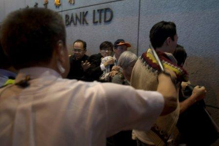 Then-police superintendent Frankly Chu beats a passerby with a baton during the 2014