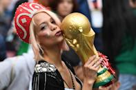 <p>A Russian fan kisses a replica of the FIFA 2018 World Cup trophy before the Russia 2018 World Cup Group A football match between Russia and Saudi Arabia at the Luzhniki Stadium in Moscow on June 14, 2018. (Photo by Kirill KUDRYAVTSEV / AFP) </p>