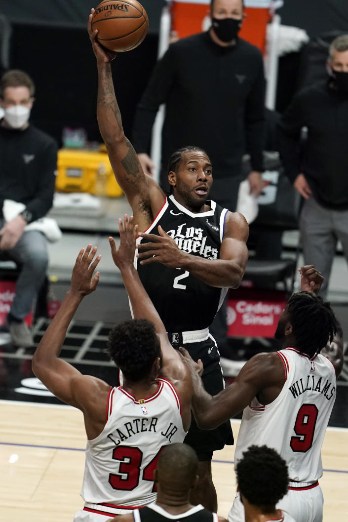 Los Angeles Clippers forward Kawhi Leonard, top, shoots against the Chicago Bulls during the first half of an NBA basketball game Sunday, Jan. 10, 2021, in Los Angeles. (AP Photo/Marcio Jose Sanchez)