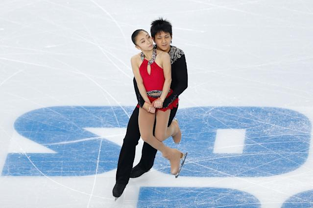 SOCHI, RUSSIA - FEBRUARY 06: Narumi Takahashi and Ryuichi Kihara of Japan compete in the Figure Skating Pairs Short Program during the Sochi 2014 Winter Olympics at Iceberg Skating Palace on February 6, 2014 in Sochi, Russia. (Photo by Matthew Stockman/Getty Images)