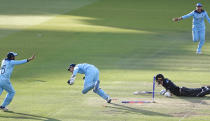 Jos Buttler runs out New Zealand's Martin Guptill to win the Cricket World Cup (AP Photo/Alastair Grant)