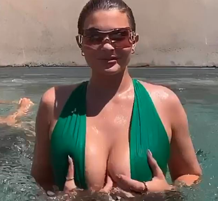 Kylie Jenner in a green swimsuit