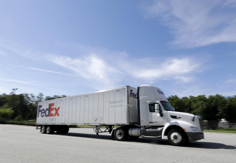 A FedEx truck leaves a distribution center in Greensboro, N.C., Tuesday, June 25, 2019. FedEx is suing the United States government over export rules it says are virtually impossible to follow because it handles millions of packages a day. (AP Photo/Chuck Burton)