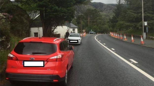 Two cars at cars at Llyn Ogwen that were towed for obstructing traffic (Picture: Police)
