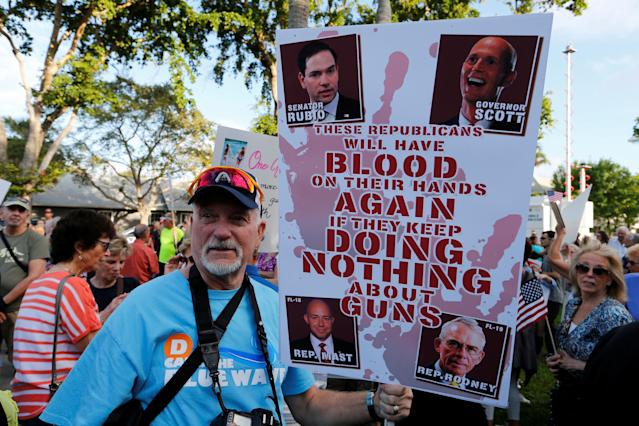 <p>Protester James Lee of Port St. Lucie, Florida, takes part in a Call To Action Against Gun Violence rally by the Interfaith Justice League and others in Delray Beach, Fla., Feb. 19, 2018. (Photo: Joe Skipper/Reuters) </p>