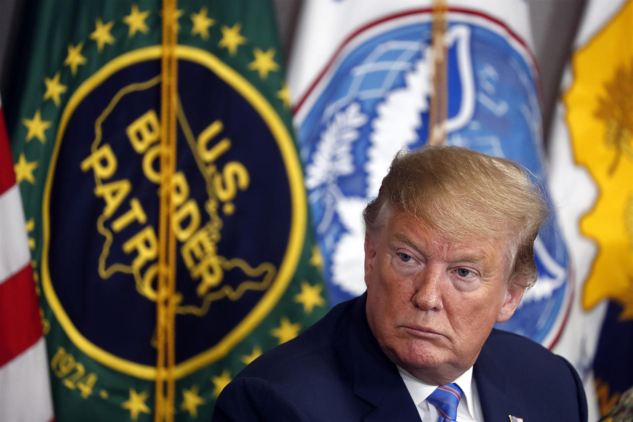 FILE - In this April 5, 2019 file photo, President Donald Trump participates in a roundtable on immigration and border security at the U.S. Border Patrol Calexico Station in Calexico, Calif. A federal judge is expected to decide Friday, May 24, 2019 whether to block the White House from spending billions of dollars to build a wall on the Mexican border with money secured under President Donald Trump's declaration of a national emergency. California and 19 other states, along with environmentalists, civil liberties groups and communities along the border, are seeking a temporary injunction to halt construction plans.(AP Photo/Jacquelyn Martin, File)