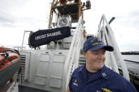 """U.S. Coast Guard Lt. Kelli Normoyle, Commanding Officer of the Coast Guard Cutter Sanibel, descends stairs aboard the vessel, Thursday, Sept. 16, 2021, at a shipyard in North Kingstown, R.I. Normoyle was one of two cadets who formally started the process to create the CGA Spectrum Diversity Council just a few months after the law known as """"don't ask, don't tell"""" was repealed on Sept. 20, 2011. (AP Photo/Steven Senne)"""