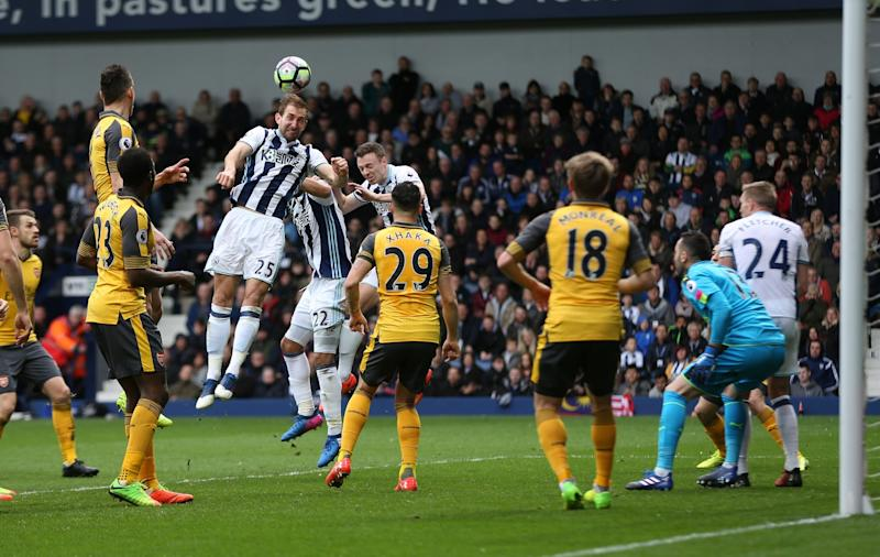 Arsenal players ball watch as Craig Dawson scores his side's third goal