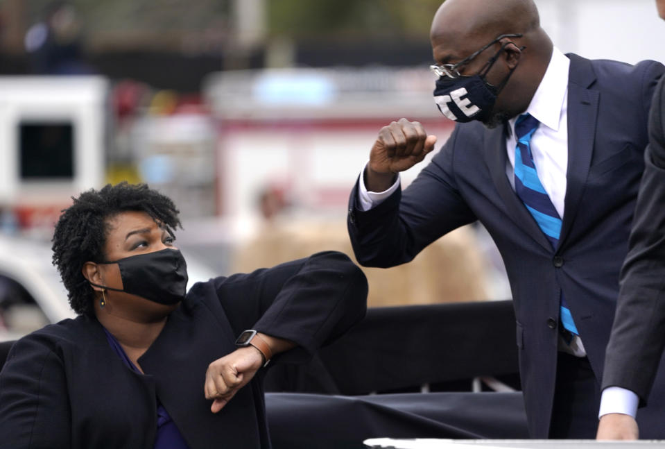 Stacey Abrams and Raphael Warnock