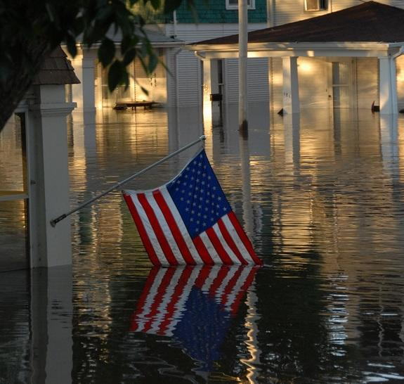A submerged American flag shows the devastation of a flood in downtown Cedar Rapids, Iowa, June 13, 2008.
