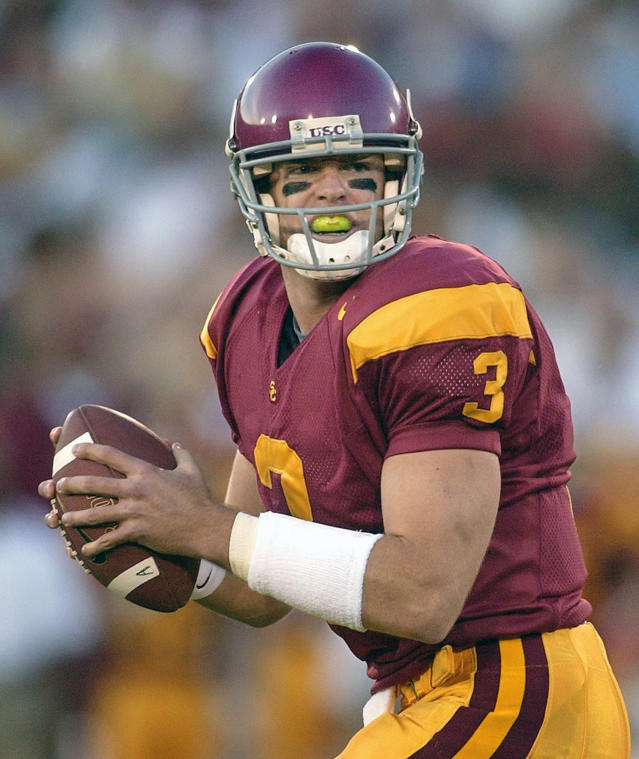 FILE - In this Nov. 16, 2002, file photo, University of Southern California quarterback Carson Palmer looks to pass during the first half of an NCAA college football game against Arizona State, in Los Angeles. Heisman Trophy winner Carson Palmer and Vince Young will make their first appearances on the College Football Hall of Fame ballot. The National Football Foundation released Monday, June 4, 2018, the names of 76 players and six coaches from major college football who will be considered for the Hall of Fame this year.(AP Photo/Mark J. Terrill, File)
