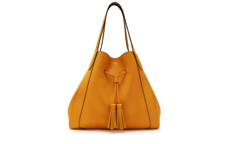 "<p>Yellow was dubbed the colour of the summer last year so it comes as no surprise to the sunny hue high on our wish list once again – it's sure to pack a punch with even the most thrown-together of looks come Monday morning. <a rel=""nofollow"" href=""https://www.mulberry.com/gb/shop/women/coming-soon/millie-tote-deep-amber-heavy-grain""><em>Shop now</em></a>. </p>"