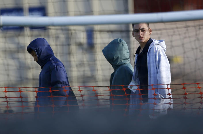 File-This Dec. 13, 2018, file photo shows migrant teens walking inside the Tornillo detention camp in Tornillo, Texas. The nonprofit group running what was once the nation's largest detention camp for migrant children confirmed it is closing down the facility and the last kids left on Friday, Jan. 11, 2019. (AP Photo/Andres Leighton, File)