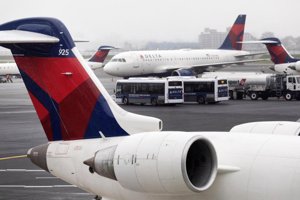 FILE - In this Oct. 29, 2019, file photo Delta Air Lines planes operate at the new $3.9 billion Terminal C at LaGuardia Airport in New York. The Atlanta-based carrier will report financial results Tuesday, Jan. 14, 2020. (AP Photo/Mark Lennihan, File)