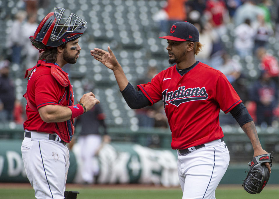 Cleveland Indians relief pitcher Emmanuel Clase is greeted by Austin Hedges after they defeated the Detroit Tigers in a baseball game in Cleveland, Sunday, April 11, 2021. (AP Photo/Phil Long)