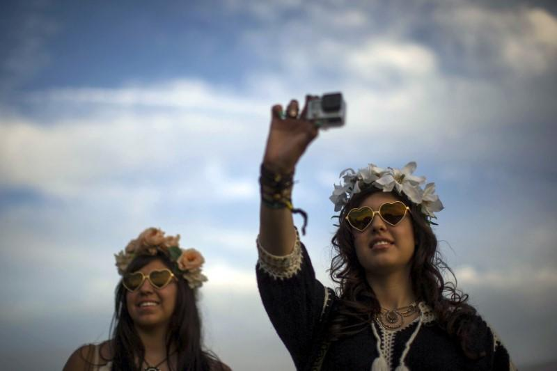 Women record GoPro video at the Coachella Valley Music and Arts Festival in Indio
