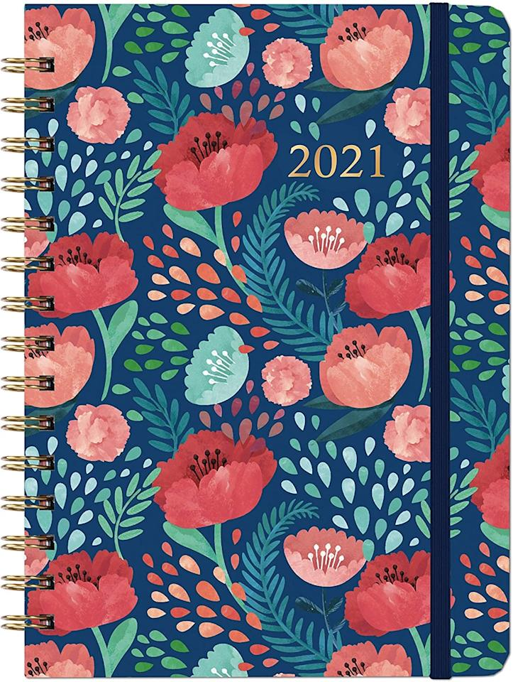 """<p>Keep track of your goals next year with this <product href=""""https://www.amazon.com/Planner-2021-Monthly-Hardcover-Twin-Wire/dp/B08CVTPZ8F/ref=sr_1_5?dchild=1&amp;keywords=planners&amp;qid=1602543638&amp;sr=8-5"""" target=""""_blank"""" class=""""ga-track"""" data-ga-category=""""internal click"""" data-ga-label=""""https://www.amazon.com/Planner-2021-Monthly-Hardcover-Twin-Wire/dp/B08CVTPZ8F/ref=sr_1_5?dchild=1&amp;keywords=planners&amp;qid=1602543638&amp;sr=8-5"""" data-ga-action=""""body text link"""">Weekly &amp; Monthly 2021 Planner with Tabs</product> ($11).</p>"""