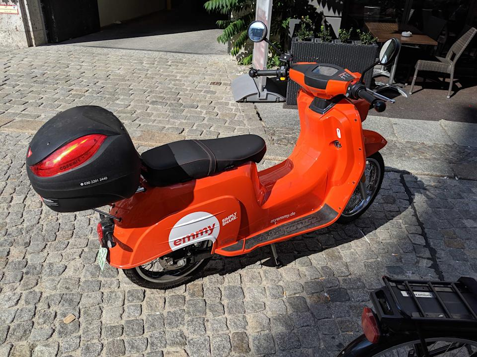 The Emmy electric scooter app is powered by Wunder Mobility. A user unlocks the scooter with an app and there's a helmet inside. (Yahoo Finance)