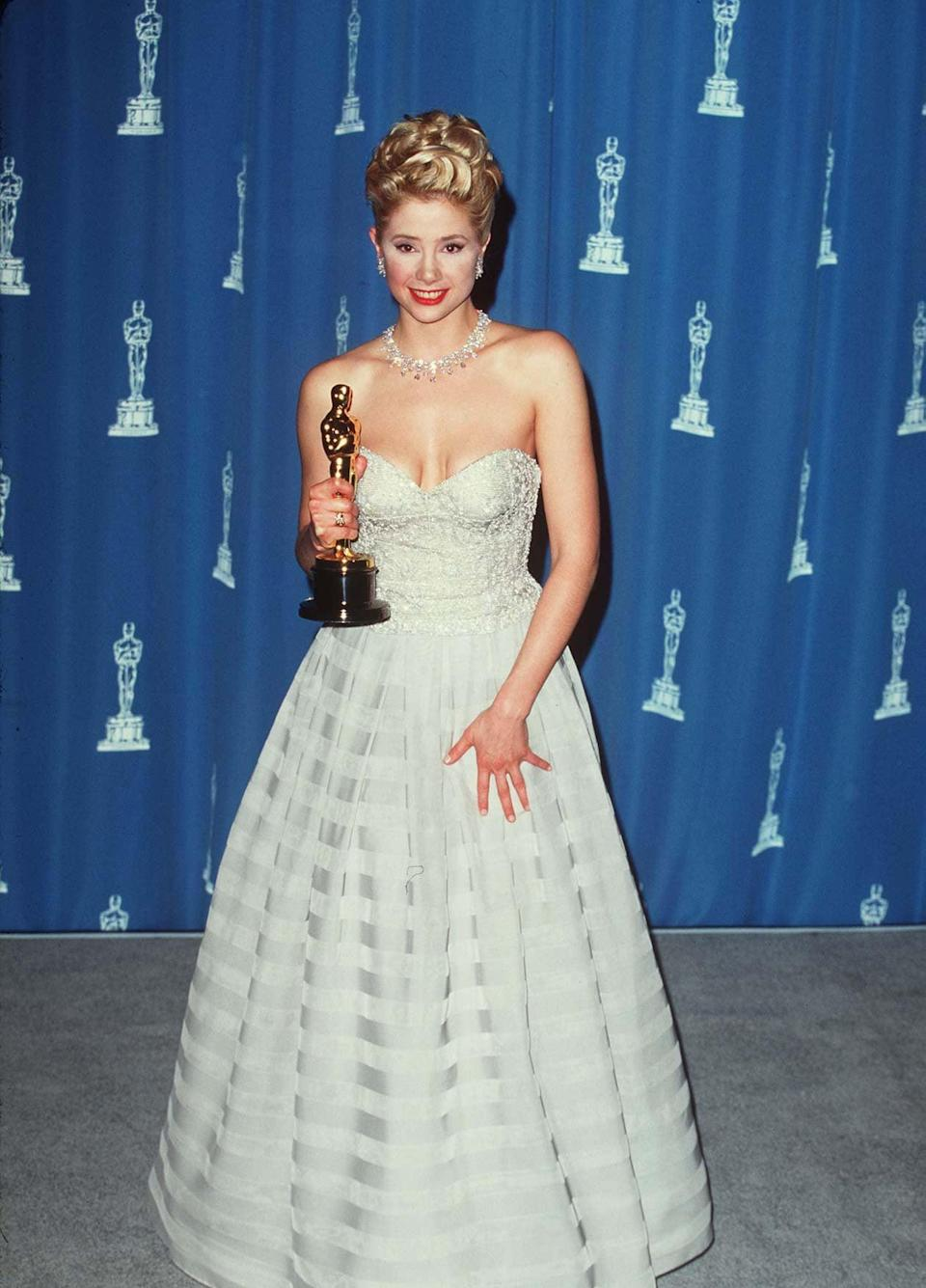 <p>Mira stunned in this strapless Armani gown at the Oscars in 1996. </p>