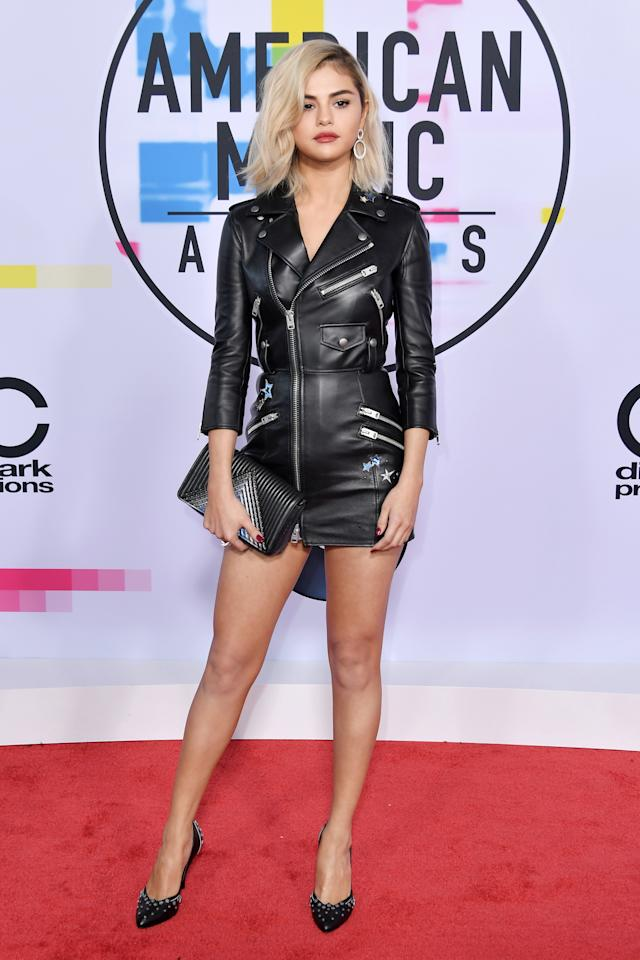 Gomez wore her edgiest look yet in this biker-chic mini on the American Music Awards red carpet. See it here.