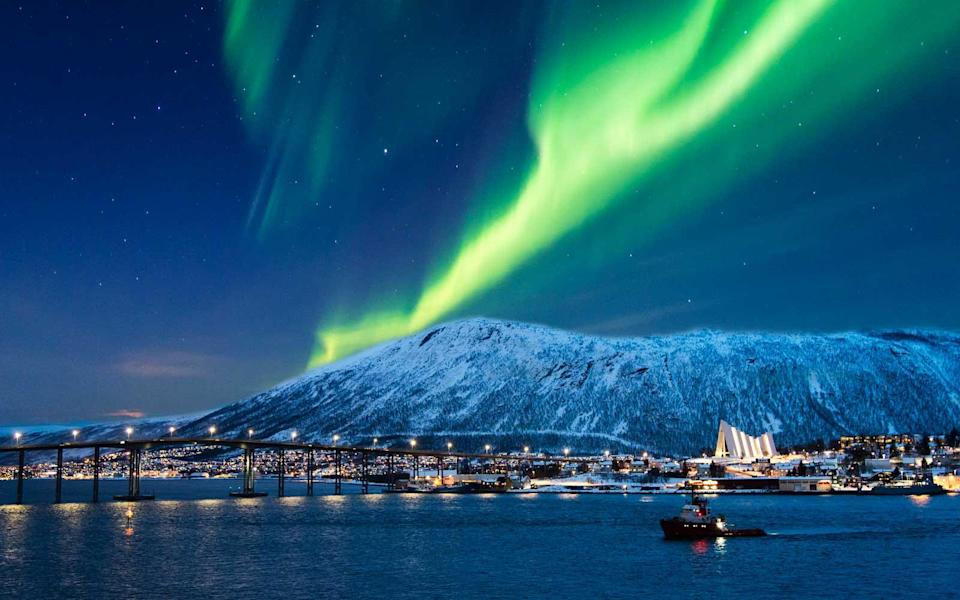 """<p>Tromsø is above the Arctic Circle at 69° N, so experiences the Polar Night from the end of November to the end of January. Head there for the <a rel=""""nofollow noopener"""" href=""""http://www.msm.no/polar-night-halfmarathon.242499.en.html"""" target=""""_blank"""" data-ylk=""""slk:Polar Night Halfmarathon"""" class=""""link rapid-noclick-resp"""">Polar Night Halfmarathon</a> on January 6, 2018, an event that last year attracted 1,700 people.</p>"""