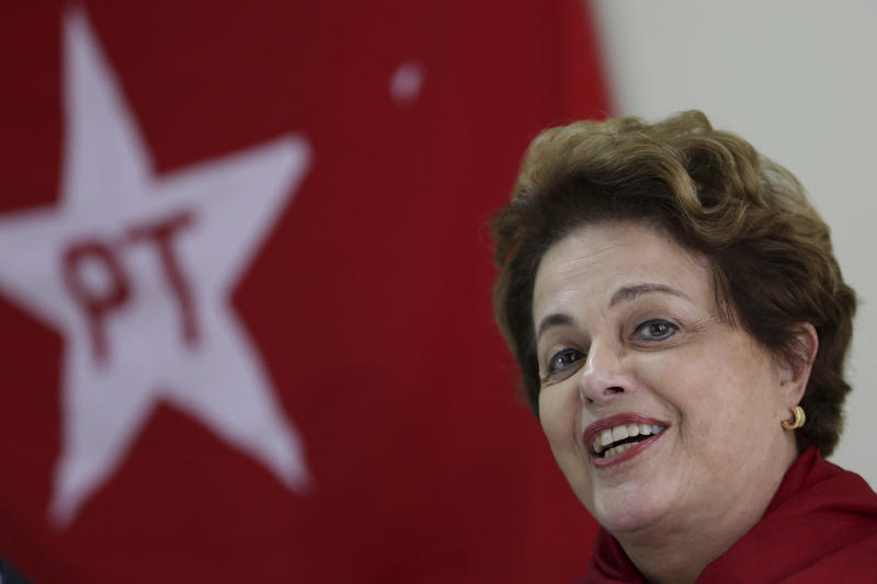 Brazil's former President Dilma Rousseff speaks during a Workers' Party National Executive members meeting to discuss the replacement of jailed presidential candidate, former President Luiz Inacio Lula da Silva, in Curitiba, Brazil, Tuesday, Sept. 11, 2018. While da Silva leads preference polls, he is serving a 12-year sentence for corruption and has been barred from running. The party is expected to announce that vice presidential candidate Fernando Haddad will replace da Silva. (AP Photo/Eraldo Peres)