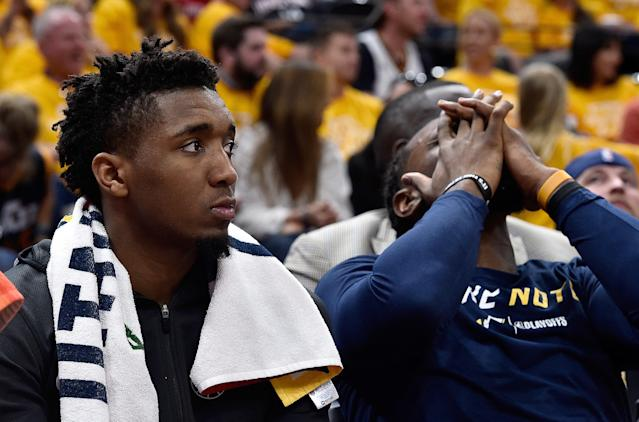 Donovan Mitchell (left) struggled to the worst performance of his young postseason career, and Jae Crowder (right) and the rest of the Jazz felt the pain of a blowout loss. (Getty)