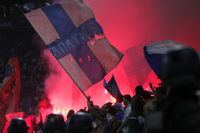 Fans set off flares during the Europa League Final soccer match between Marseille and Atletico Madrid at the Stade de Lyon in Decines, outside Lyon, France, Wednesday, May 16, 2018. (AP Photo/Thibault Camus)