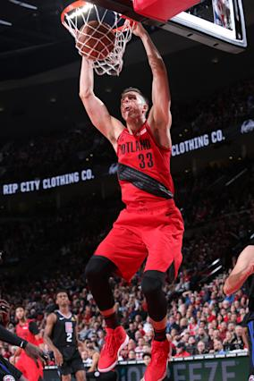 PORTLAND, OR - NOVEMBER 8: Zach Collins #33 of the Portland Trail Blazers drives to the basket during the game against the LA Clippers on November 8 2018 at the Moda Center Arena in Portland, Oregon. (Photo by Sam Forencich/NBAE via Getty Images)