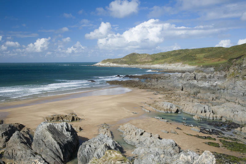A view over the rocks of Barricane Beach in Woolacombe, North Devon [Photo: Getty]