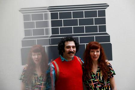 Artists Michael Rakowitz and Heather Phillipson pose for a photograph after they both won the competition to make a piece to be displayed on the fourth plinth in Trafalgar Square, in central London