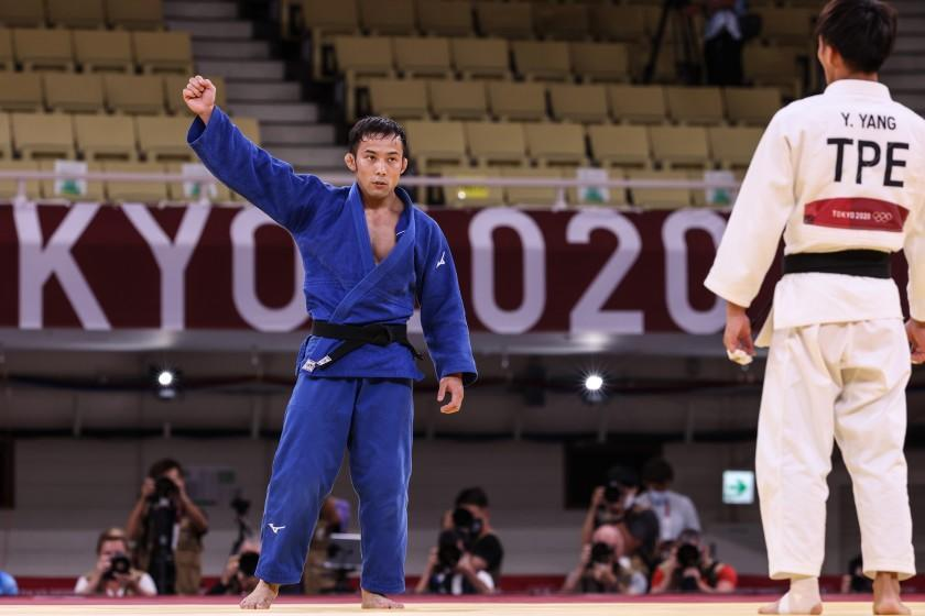 Tokyo, Japan, Friday, July 24, 2021 - Naohisa Takato of Japan battles celebrates after defeating Yung Wei Yang of Teipei in the Judo men's 60kg final. Takato won the gold medal by a Golden Score Nippon at Nippon Budokan at the Tokyo 2020 Olympics Opening Ceremony at Olympic Stadium. (Robert Gauthier/Los Angeles Times)