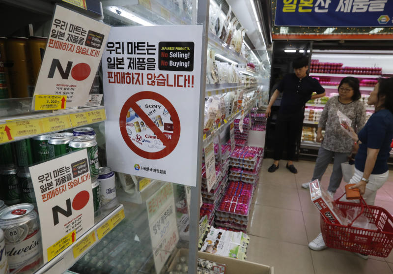 "FILE - In this Tuesday, July 9, 2019, file photo, notices campaigning for a boycott of Japanese-made products are displayed at a store in Seoul, South Korea. South Koreans believe Japan still hasn't fully acknowledged responsibility for atrocities committed during its 1910-45 colonial occupation of Korea. Thousands of South Koreans have signed petitions posted on the presidential office's website that call for boycotting Japanese products and travel to Japan. The signs read: ""We don't sell Japanese products."" (AP Photo/Ahn Young-joon)"