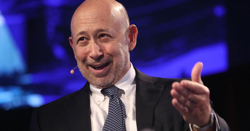Goldman Sachs posts earnings and sales beat, but trading falls 50%