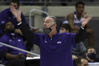 TCU coach Jamie Dixon gestures during the team's NCAA college basketball game against Kansas State on Saturday, Feb. 20, 2021, in Fort Worth, Texas. (AP Photo/Richard W. Rodriguez)