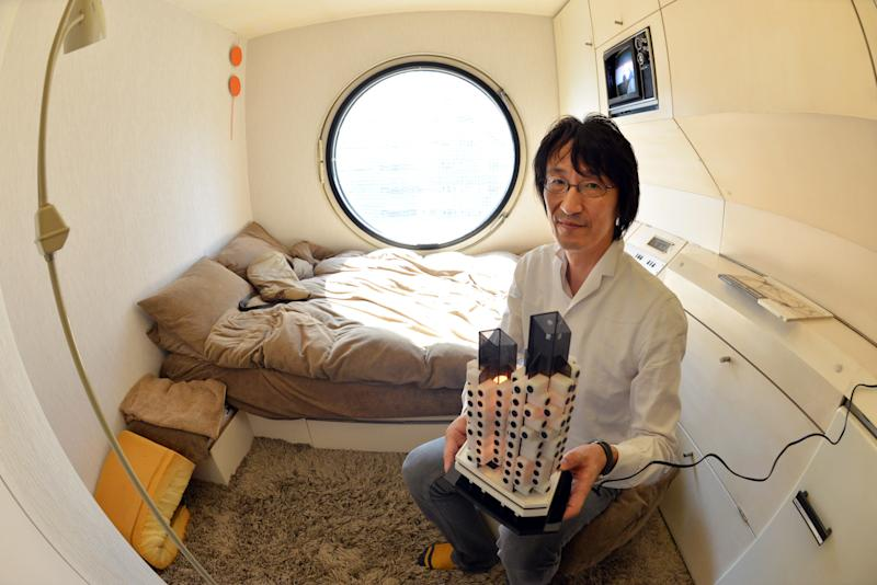 In real life, around half of the capsules are currently in use as second homes, offices and art studios, but some 20 of the tiny spaces are full-time homes (AFP Photo/Yoshikazu Tsuno)
