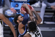 Baylor guard Davion Mitchell (45) blocks a Villanova guard Justin Moore (5) shot in the second half of a Sweet 16 game in the NCAA men's college basketball tournament at Hinkle Fieldhouse in Indianapolis, Saturday, March 27, 2021. (AP Photo/Michael Conroy)
