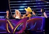 """<p>The contestants are kept in an <a href=""""https://people.com/tv/masked-singer-nick-cannon-stars-identities-secret/?utm_campaign=peoplemagazine&xid=socialflow_twitter_peoplemag&utm_medium=social&utm_source=twitter.com"""" rel=""""nofollow noopener"""" target=""""_blank"""" data-ylk=""""slk:entirely separate area"""" class=""""link rapid-noclick-resp"""">entirely separate area</a> from the panelists on set. The only time the contestants can interact with them is when they're onstage in costume.<br></p>"""