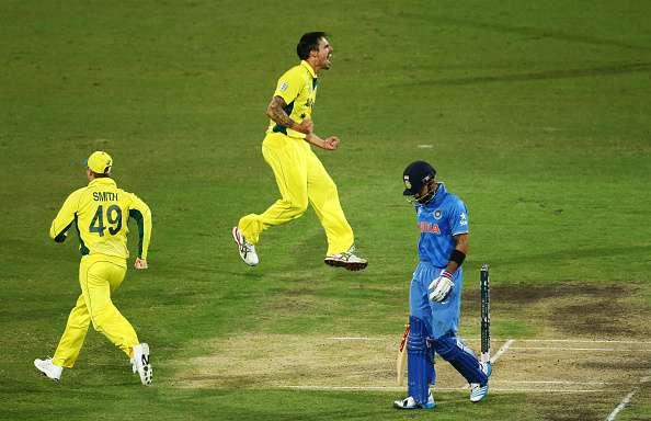 SYDNEY, AUSTRALIA - MARCH 26: Mitchell Johnson of Australia celebrates taking the wicket of Virat Kohli of India during the 2015 Cricket World Cup Semi Final match between Australia and India at Sydney Cricket Ground on March 26, 2015 in Sydney, Australia. (Photo by Matt King/Getty Images)
